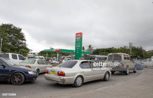 Motorists queue up to get fuel in panic in light of the escalating violence following a protest rally by the students in Port Moresby on June 8 2016...