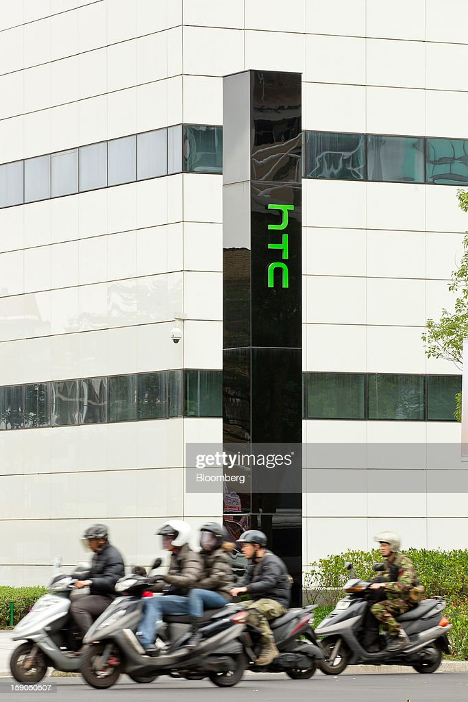 Motorists ride past the HTC Corp. headquarters in New Taipei, Taiwan, on Sunday, Jan. 6, 2013. HTC is scheduled to release fourth-quarter earnings on Jan. 7. Photographer: Maurice Tsai/Bloomberg via Getty Images