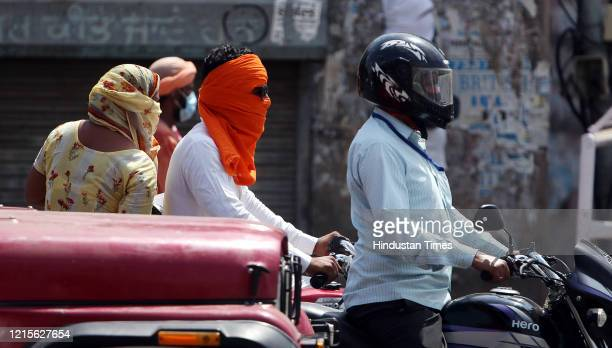 Motorists spotted at Hanuman Chowk with their heads wrapped up to protect from the scorching heat on a summer day on May 27, 2020 in Bathinda, India.