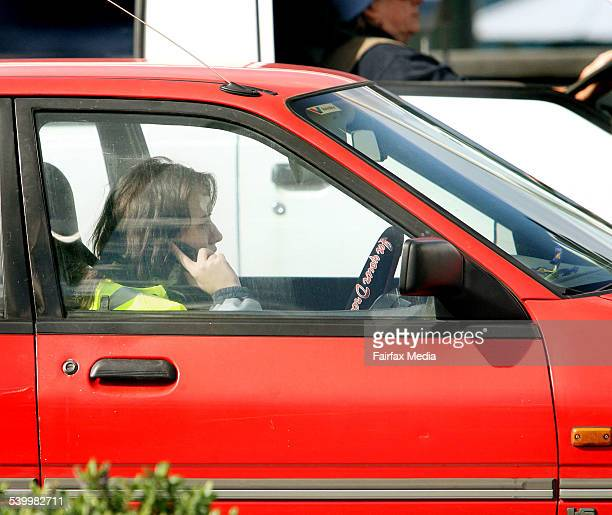 Motorists talking on mobile phones while driving in traffic at Campbell Parade Bondi 5 August 2006 SHD Picture by FIONALEE QUIMBY