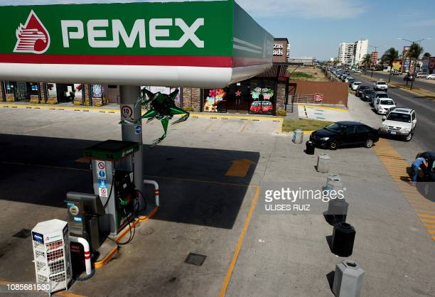 Motorists wait in line for hours to buy gasoline at a Pemex service station in Zapopan Jalisco state on January 20 2019 Mexican President Andres...