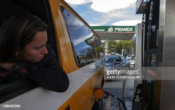 Motorists wait in line for hours to buy gasoline at a Pemex service station in Monterrey Nuevo Leon state on January 22 2019 Mexican President Andres...