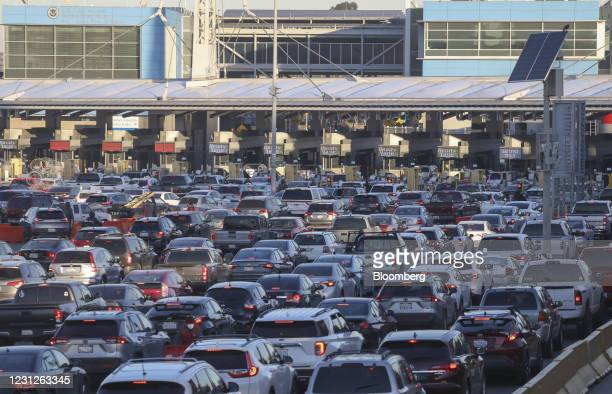 Motorists wait in line to cross the border at the Port of Entry in Tijuana, Mexico, on Friday, Feb. 19, 2021. After waiting months and sometimes...