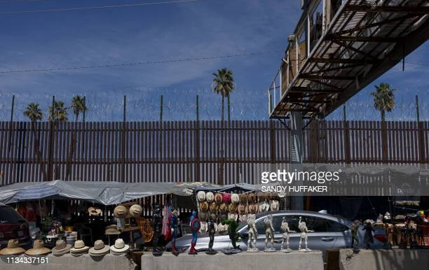 Motorists wait in line to cross the border in Mexicali, Mexico at the Port of Entry to the United States on April 1, 2019. - US President Donald...
