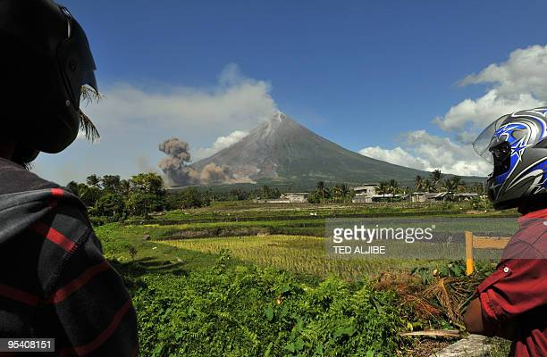 Motorists watch as pyroclastic ash billows from the foothills of the Mayon volcano in the city of Legazpi in Albay province 330 kms southeast of...