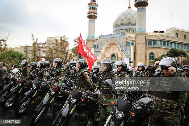 Motorized Basij members attend a rally marking the 35th anniversary of the Basij , a paramilitary volunteer militia established in 1979 by order of...