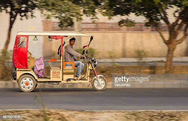 motorized electric rickshaw, new delhi, india - rickshaw stock photos and pictures