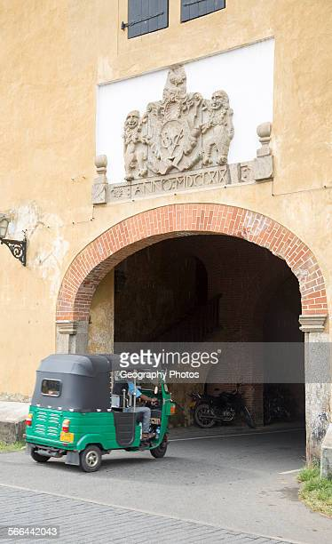 Motorized rickshaw at fort doorway exit in the historic town of Galle Sri Lanka Asia