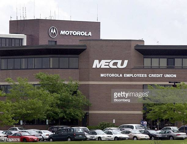 Motorola employees stand near the front door of the Motorola Employees Credit Union building on the Motorola corporate campus in Schaumburg Illinois...