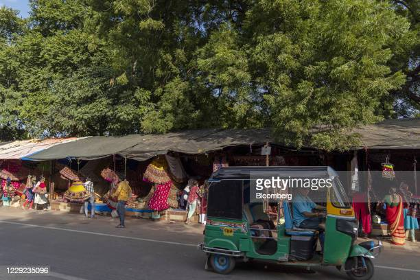 Motor-rickshaw travels past stalls at the Law Garden Market in Ahmedabad, India, on Thursday, Oct. 22, 2020. Prime MinisterNarendra Modisaid his...