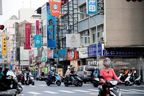 motorscooters on a city street, beimen street, taipei, taiwan - hualien county stock pictures, royalty-free photos & images