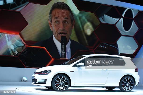 Motorsport legend Jacky Ickx talks during the presentation of the Volkswagen Golf GTI on the stand of German carmaker Volkswagen on September 27 2012...