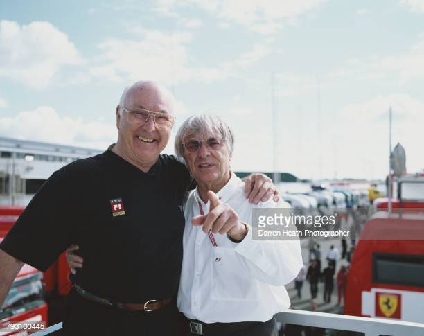 Motorsport television commentator and journalist Murray Walker poses for a portrait beside President and CEO of Formula One Management and Formula...