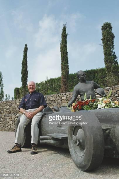 Motorsport television commentator and journalist Murray Walker poses for a portrait beside the Joaquim Ros i Sabate sculpture of Juan Manuel Fangio...