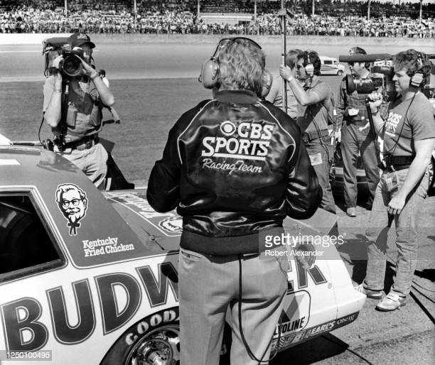 Motorsports journalist and CBS television NASCAR commentator Chris Economaki broadcasts from pit road prior to the start of the 1985 Daytona 500...