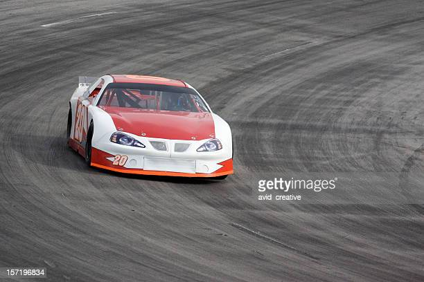 motorsports-red and white race car - nascar stock pictures, royalty-free photos & images