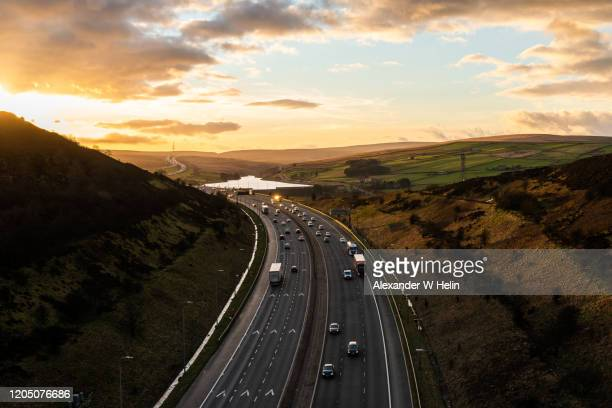 motorway going through the english countryside - multiple lane highway stock pictures, royalty-free photos & images