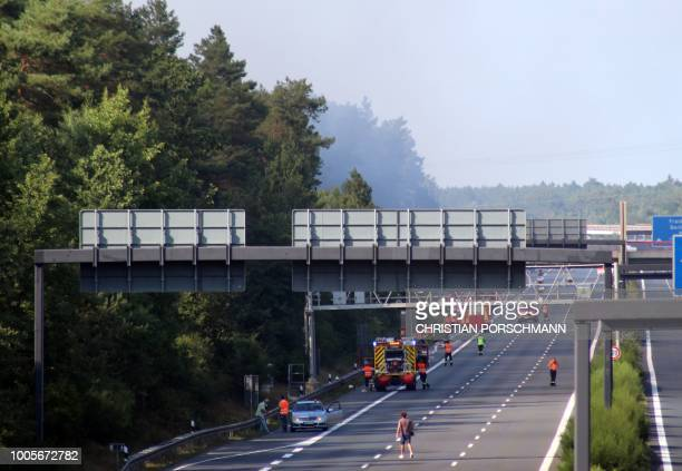 A motorway is blocked as Firefighters tackle a forest fire near Potsdam eastern Germany on July 26 2018 Dozens of wildfires have hit countries across...