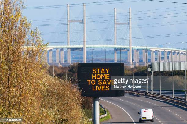 """Motorway matrix sign which says """"stay home to save lives"""" in front of the Prince of Wales bridge, formerly the Second Severn Crossing, which connects..."""