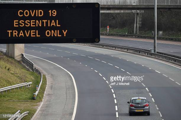 A motorway sign on the M8 motorway advising on essential travel only on March 24 2020 in Glasgow Scotland First Minister of Scotland Nicola Sturgeon...