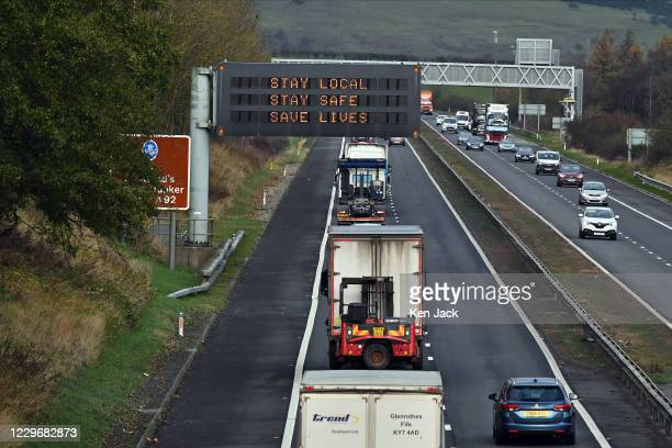 "Motorway signs carries a ""Stay Local"" message as the Scottish Government prepares to put travel restrictions into law from this week, on November 19,..."