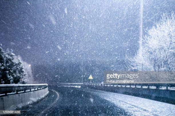 motorway  snow night - blizzard stock pictures, royalty-free photos & images
