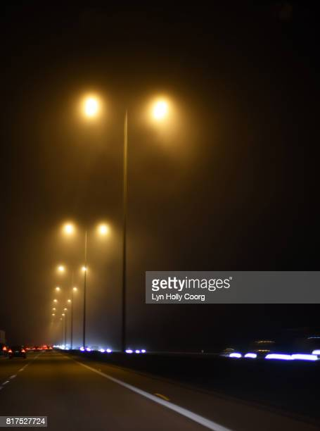 motorway street lamps and car headlights at night - lyn holly coorg stock pictures, royalty-free photos & images