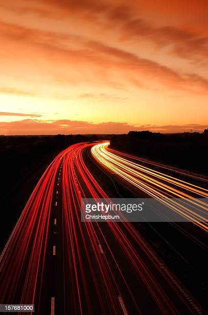 motorway sunset - two lane highway stock pictures, royalty-free photos & images