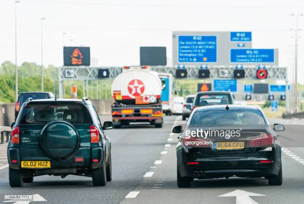 uk motorway traffic and signs - rear view photos stock photos and pictures