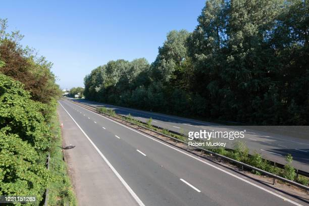 motorway traffic spring 2020 - motorway stock pictures, royalty-free photos & images