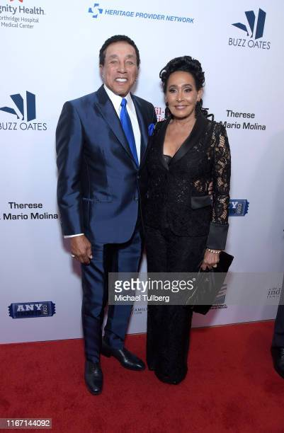 Motown legend Smokey Robinson and Frances Glandney attend the 19th annual Harold and Carole Pump Foundation Gala at The Beverly Hilton Hotel on...