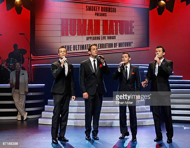 Motown legend Smokey Robinson looks on as Australian vocal group Human Nature Andrew Tierney Toby Allen Michael Tierney and Phil Burton performs...