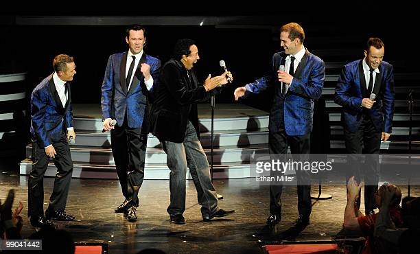 Motown legend Smokey Robinson reacts after singing with Australian vocal group Human Nature Michael Tierney Phil Burton Toby Allen and Andrew Tierney...