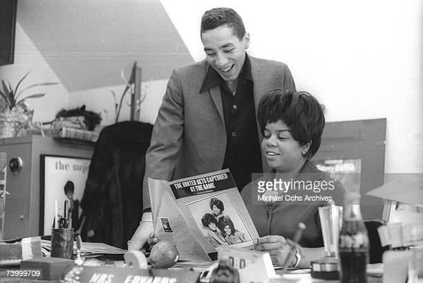 Motown Records vice president Esther Gordy Edwards chats with Motown artist and songwriter Smokey Robinson in her Motown Records office in 1967 in...