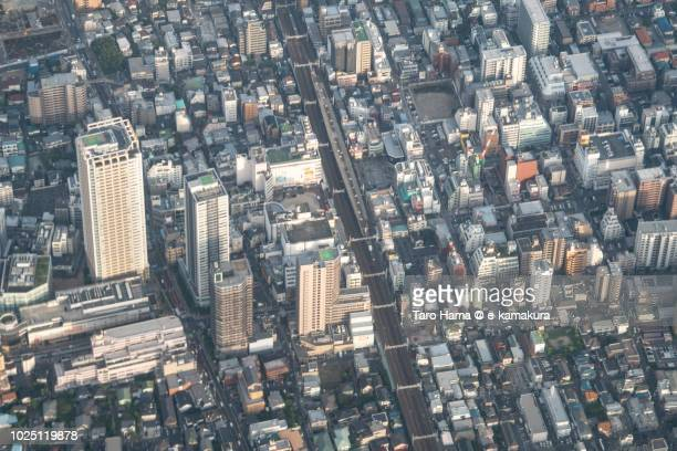 motoyawata station of jr sobu line in ichikawa city in chiba prefecture in japan sunset time aerial view from airplane - chiba city fotografías e imágenes de stock