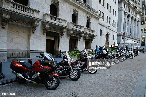 Motrcycles are displayed during as members of Kiehl's and amfAR Ring the New York Stock Exchange opening bell in honor of the Kiehl's LifeRide for...