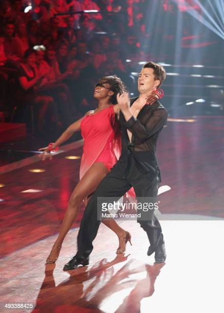 Motsi Mabuse and Evgenij Voznyuk attend the 8th Show of 'Let's Dance' on May 23 2014 in Cologne Germany