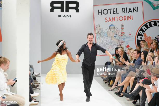 Motsi Mabuse and Evgenij Voznyuk perform ahead the runway at the Riani Fashion Show Spring/Summer 2018 at Umspannwerk Kreuzberg on July 4 2017 in...