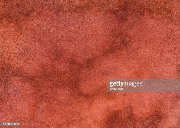 Mottled distressed background with shades of orange rust