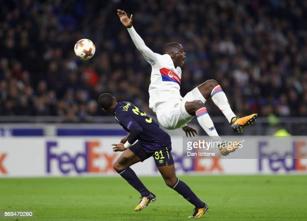 Mouctar Diakhaby of Lyon and Ademola Lookman of Everton battle for possession during the UEFA Europa League group E match between Olympique Lyon and...