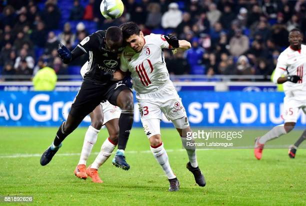 Mouctar Diakhaby of Lyon and Junior Alonso of Lille during the Ligue 1 match between Olympique Lyonnais and Lille OSC at Parc Olympique on November...