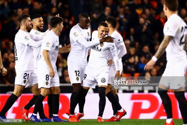 Mouctar Diakhaby of Valencia CF celebrate after scoring the 10 goal with his teammate during spanish La Liga match between Valencia CF vs Villarreal...