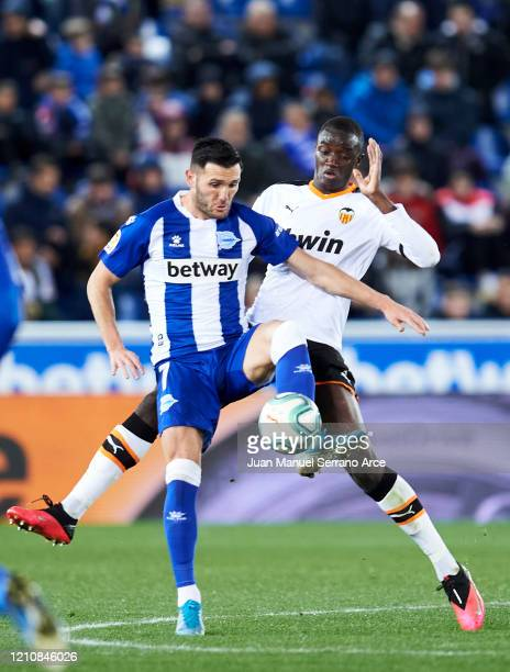 Mouctar Diakhaby of Valencia CF duels for the ball with Lucas Perez of Deportivo Alaves during the Liga match between Deportivo Alaves and Valencia...
