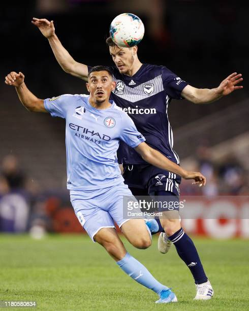 Moudi Najjar of Melbourne City and James Donachie of the Victory contest the ball during the round one ALeague match between the Melbourne Victory...