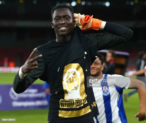 Mouhamed Mbaye of Porto FC celebrates winning the Trophy twice After Premier League International Cup Final match between Arsenal Under 23 against...