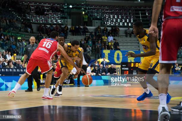 Mouhammadou Jaiteh, Dallas Moore and Tyler Cain are seen in action during the Euro-cup match between Auxilium Fiat Torino and Openjobmetis Varese....