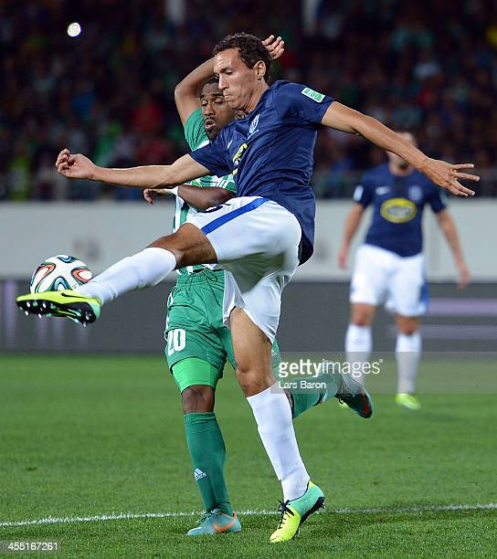 Mouhssine Iajour of Casablanca challenges Angel Berlanga of Aucklandduring the FIFA Club World Cup Playoff for Quarter Final match between Raja...