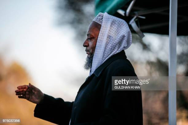 Moulana Abu Bakr speaks at the EidGah the prayer on the morning of the Eid AlFitr celebration which marks the end of the holy month of Ramadan on...