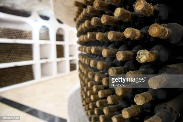 Mould-covered bottles of vintage wines are seen at the world's largest Cricova wine cellar, located outside Moldova's capital . Chisinau, Moldova on...