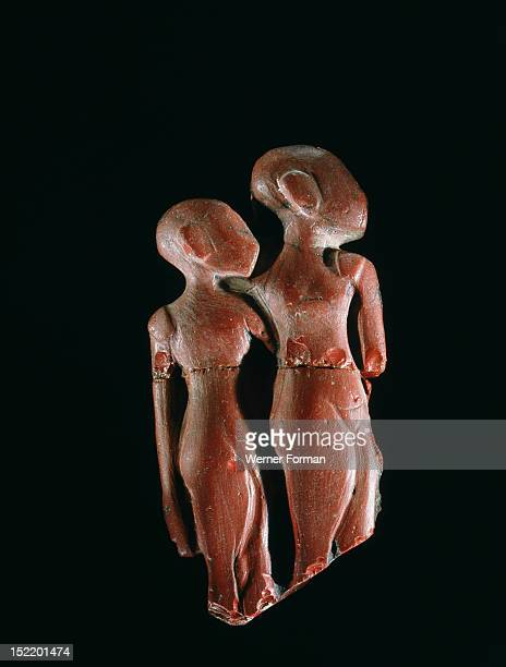 Moulded red glass figures considered to be Amarna princesses Egypt Ancient Egyptian 18th dynasty c 1378 1362 BC Amarna period